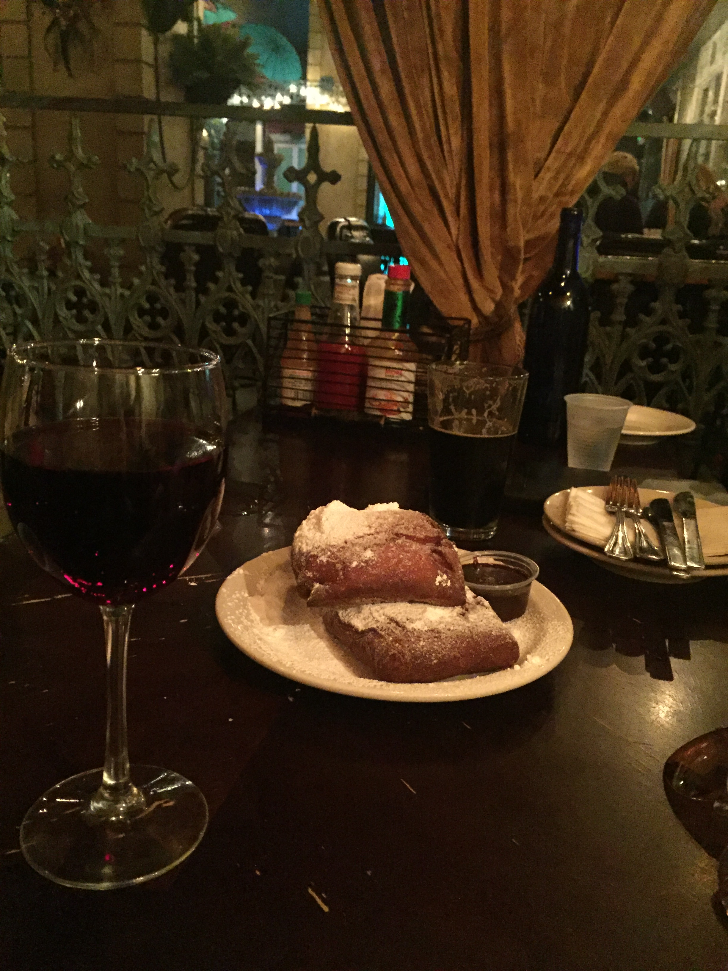 "alt=""glass red wine & pastries"""