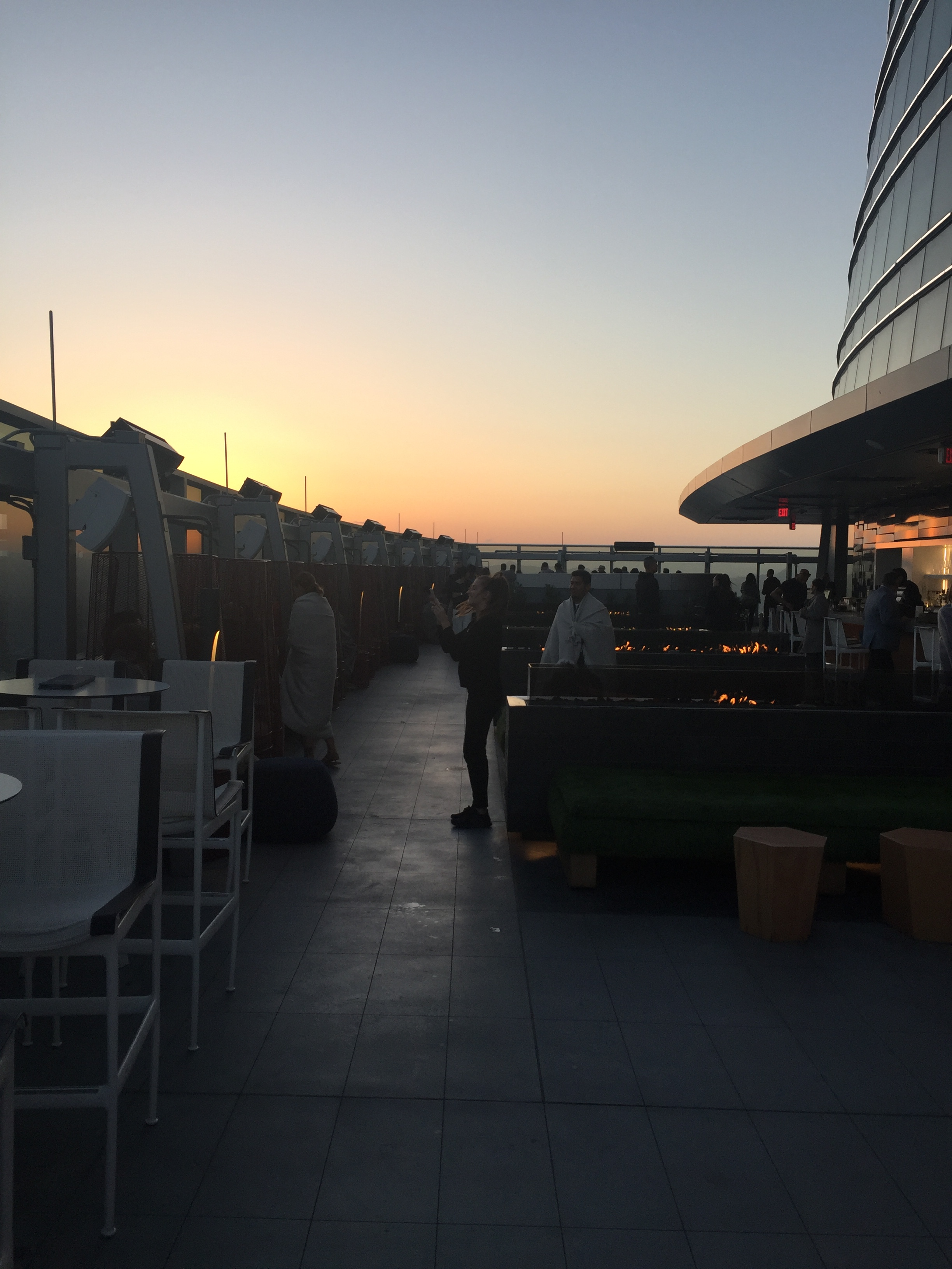 "alt=""roof top bar at sunset"""