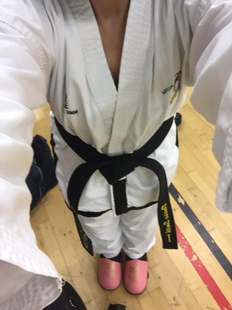 "alt=""woman in taekwondo sparring kit"""