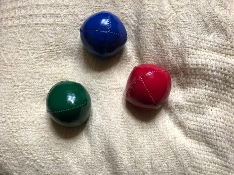 """alt=""""three coloured juggling balls"""""""