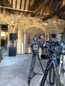 "alt=""cameras on tripods in foreground in woodyard barn"""